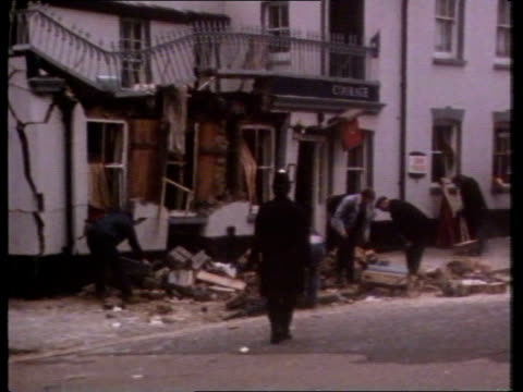 guilford pub bomb case reopened; tx 6.10.74 england london guildford workers clearing debris outside 'horse & groom' pub pull out av sign 'horse &... - guildford stock videos & royalty-free footage