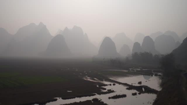 guilin hills at dusk ,china - guilin stock videos & royalty-free footage