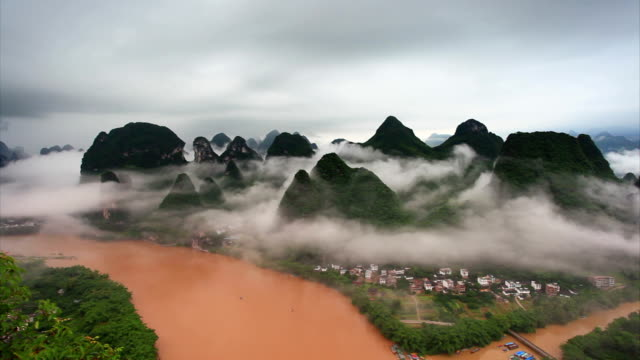 guilin hills in mist at sunrise,xingping,yangshuo,china - guilin stock videos & royalty-free footage
