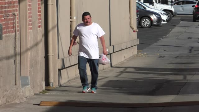 stockvideo's en b-roll-footage met guillermo rodriguez brings takeout food into jimmy kimmel live at el capitan theater in hollywood in celebrity sightings in los angeles - el capitan theater