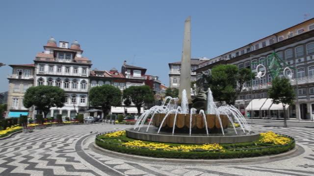 guimaraes, toural square, unesco world heritage - ポルトガル点の映像素材/bロール