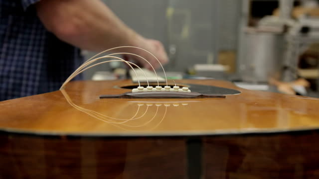 cu guitar being threaded and tuned / nazareth, pennsylvania, usa - guitar stock videos & royalty-free footage