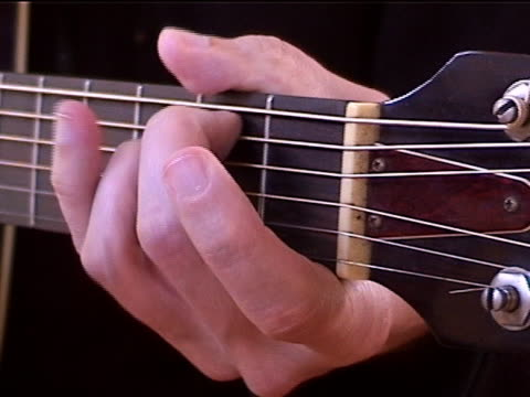 guitar chords - plucking an instrument stock videos & royalty-free footage