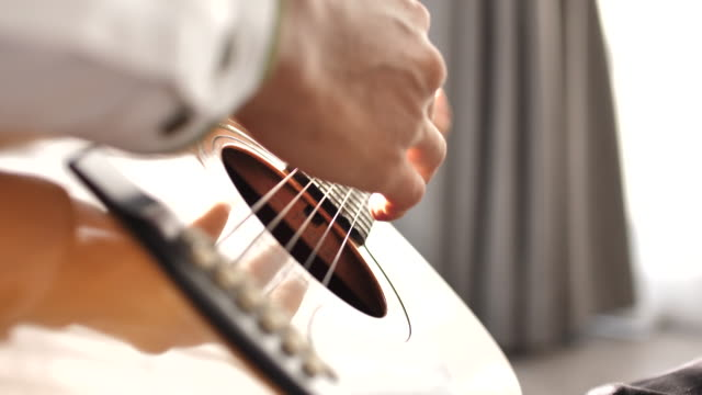 guitar in musician hands - musical instrument string stock videos & royalty-free footage