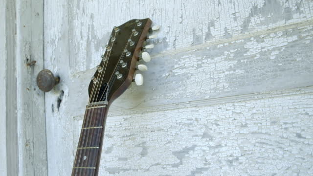 CU Guitar leaning against white door / Tennessee, United States