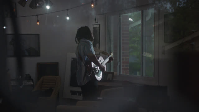 guitar musician plays alone in his house - musician stock videos & royalty-free footage