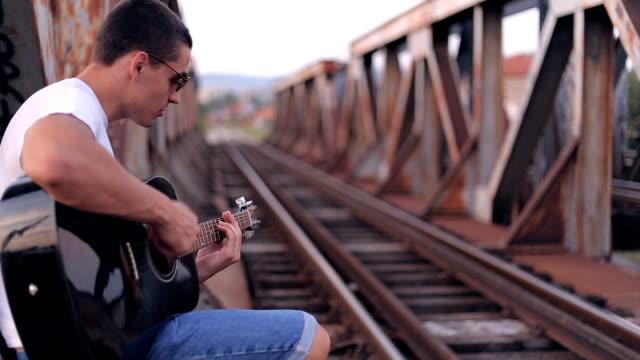 guitar player on old bridge - singer stock videos & royalty-free footage