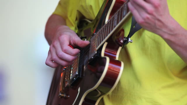 guitar player on stage close-up - gitarre stock videos & royalty-free footage
