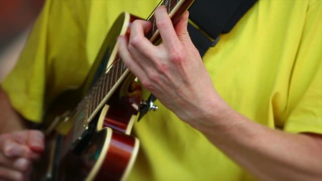 guitar player performing on open stage close-up - gitarre stock videos & royalty-free footage