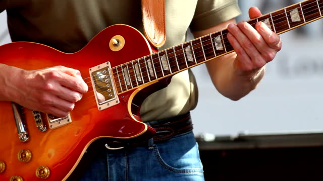 guitar player performing on open stage - electric guitar stock videos and b-roll footage