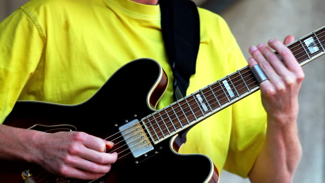 guitar player performing on open stage - plucking an instrument stock videos and b-roll footage