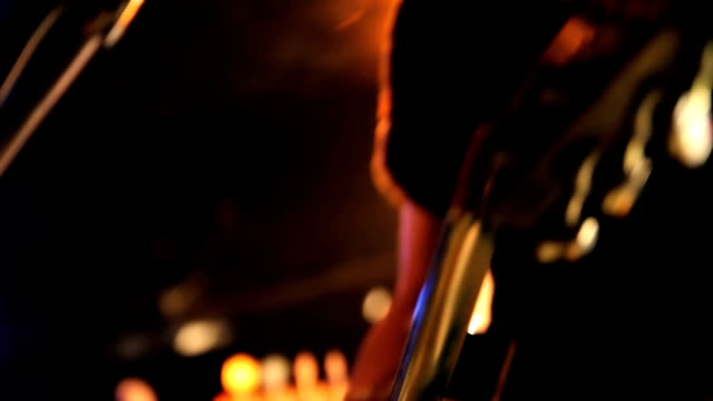 guitarist performing on stage. - electric guitar stock videos and b-roll footage