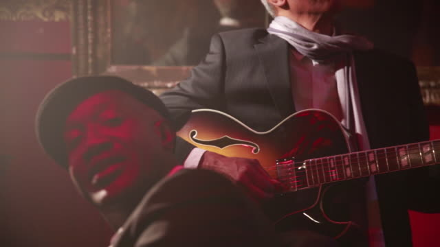 guitarist performs with his jazz band. - performer stock videos & royalty-free footage