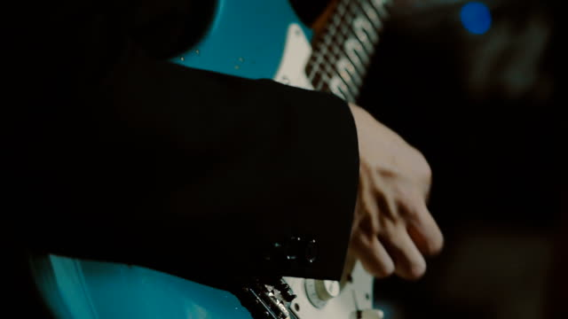 guitarist playing a guitar - rock group stock videos and b-roll footage