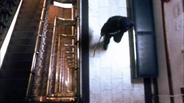vídeos y material grabado en eventos de stock de oh ws guitarist playing electric guitar in hotel hallway near staircase / new york city, new york, usa - guitarra