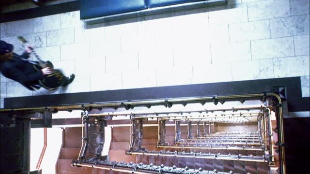 vídeos y material grabado en eventos de stock de ha ws guitarist playing electric guitar in hotel hallway near staircase / new york city, new york, usa - guitarra