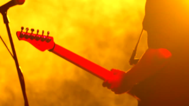 guitarist playing guitar close up - rocking stock videos & royalty-free footage