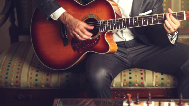 guitarist playing guitar - plucking an instrument stock videos and b-roll footage
