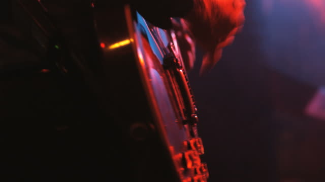 vídeos de stock, filmes e b-roll de guitarist playing in a rock and roll concert with a band - guitarist