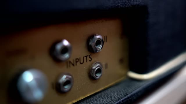 guitarist plug in on guitar amplifier - amplifier stock videos & royalty-free footage