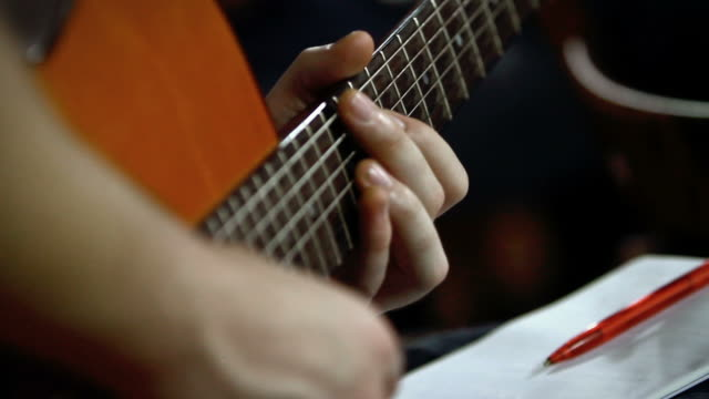Guitarist Studying Music