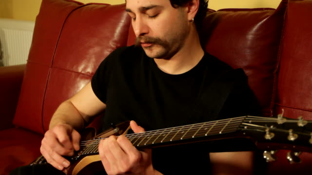 guitarist - plucking an instrument stock videos and b-roll footage