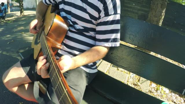 vídeos y material grabado en eventos de stock de guitarist - pov - diapasón instrumento de cuerdas