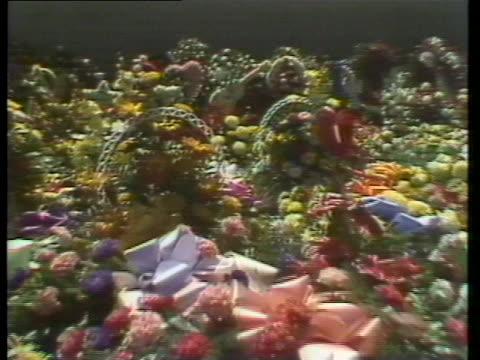 guitar-shaped flower arrangement sits among the many arrangements seen at elvis' funeral. - flower arrangement stock videos & royalty-free footage