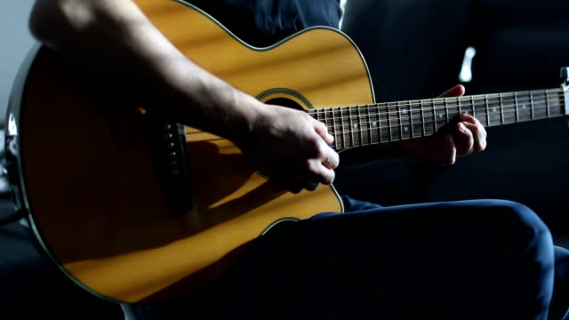 guitarst playing acoustic guitar - solo performance stock videos and b-roll footage