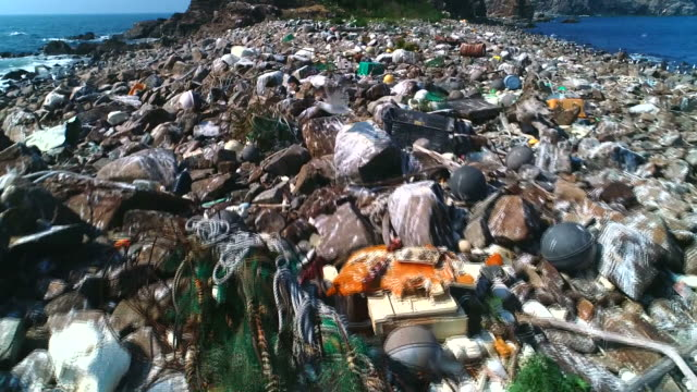 gujido island covered in garbage / ongjin-gun, incheon, south korea - stone object stock videos & royalty-free footage