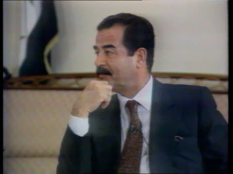 vídeos y material grabado en eventos de stock de chinese fm in baghdad british diplomat expelled f'back saddam seen during itn's intvw walking about in room - saddam hussein