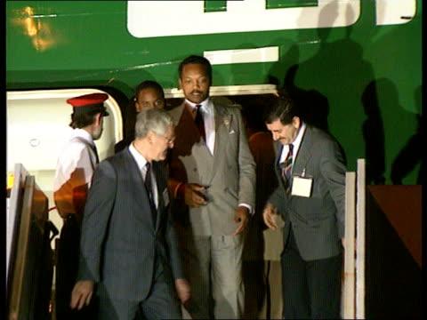 Edward Heath to meet Saddam Hussein F'back Jesse Jackson US Politician down steps of plane with released child