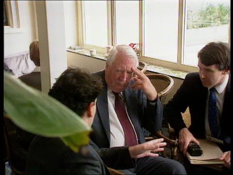 Edward Heath to meet Saddam Hussein NAT ENGLAND Bournemouth Edward Heath MP frmr PM chatting with aides in hotel Edward Heath MP pkf stmnt