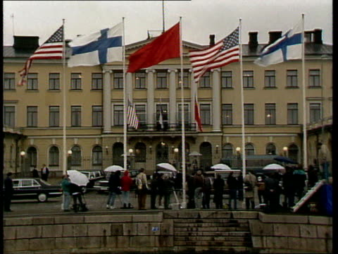 george bush and mikhail gorbachev meet in helsinki finland helsinki ext exteriors presidential palace with flags flying / sniffer dog looking in... - pointing stock videos & royalty-free footage