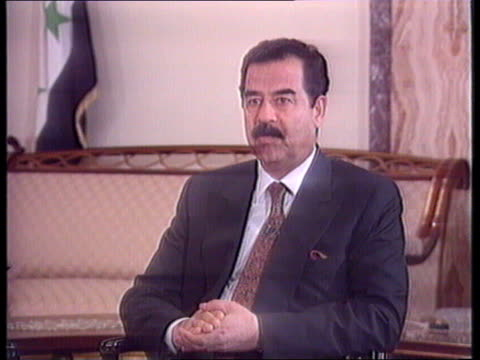saddam interview: analysis; more of saddam during intvw: tx.11.11.90/itn - saddam hussein stock videos & royalty-free footage