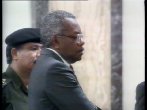 itn saddam interview analysis nao f'back baghdad trevor mcdonald walking about in room with pres saddam hussein of iraq as chatting thru interpreter... - saddam hussein stock videos & royalty-free footage