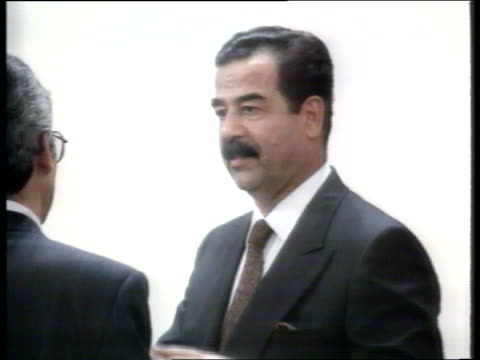 saddam interview: analysis; nat: : iraq: f'back baghdad: trevor mcdonald walking about in room with pres saddam hussein of iraq as chatting thru... - saddam hussein stock videos & royalty-free footage