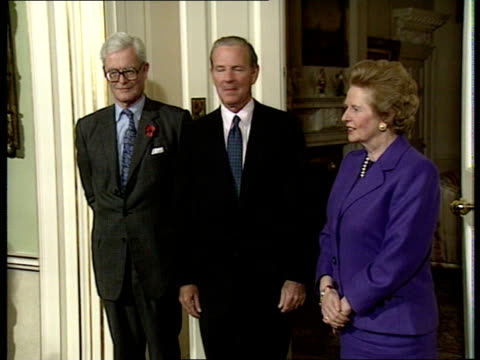James Baker visit to UK Downing St No 10 Hurd Baker PM Margaret Thatcher posing for photocall CMS Ditto PULL LMS Thatcher Hurd Baker out of No 10 for...