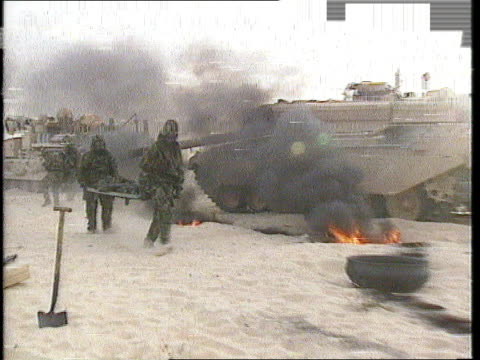 vídeos de stock, filmes e b-roll de gulf crisis large casualties warning if war breaks out saudi arabia lms chemical warfare drill as broken down tank emitting thick black smoke as... - grosso