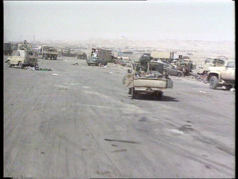 gulf war anniversary celebrations/ gulf war torture allegations; kuwait: basra road: ext track forward wreckage of fleeing vehicles caught in us... - basra video stock e b–roll
