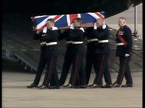 evening news; coffin carried along - coffin stock videos & royalty-free footage