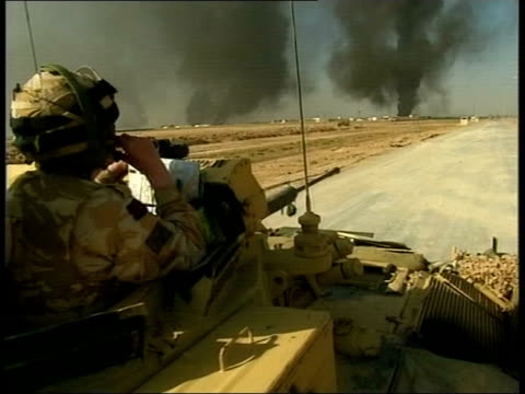 vídeos de stock, filmes e b-roll de day 10 evening news iraq basra night gv explosion as iraqi armoured vehicle blown up by royal engineers gvs burning iraqi tank destroyed by royal... - iraque