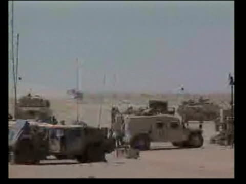 evening news; pool iraq: najaf ext us military vehicles in desert - najaf stock videos & royalty-free footage