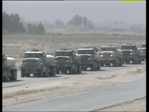 lunchtime news; pool iraq ext gvs convoy of us supply trucks along road - day 1 stock videos & royalty-free footage