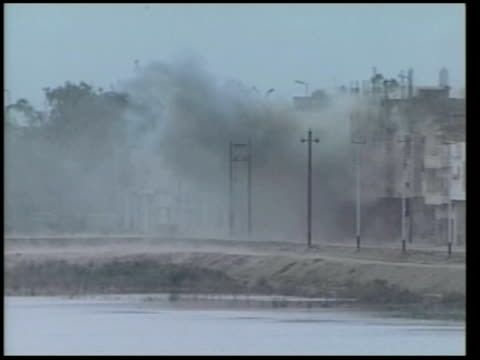 day 11 evening news itn for itv iraq nassiriya explosion as bomb dropped on iraq position zoom in smoke rising ground to air us cobra attack... - mortar weapon stock videos & royalty-free footage