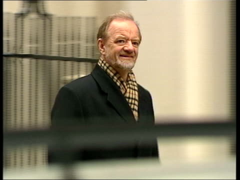 evening news; itn lib england: london: ext former cabinet minister robin cook mp along - robin day stock videos & royalty-free footage