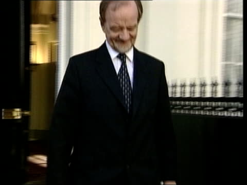 lunchtime news; itn england: london: ext robin cook mp along into car - robin day stock videos & royalty-free footage