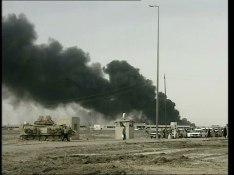day 11 Lunchtime News LIB Abandoned Iraqi armour blown up by Royal Engineers POOL Basra GV Smoke from burning oil fire British marine arresting Iraqi...