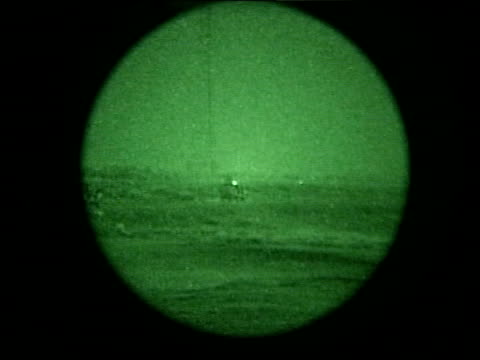 day 11 news at nine pool iraq basra british royal marines along road in jeeps green nightscope jeeps along firing during night patrol green... - iraq war stock videos and b-roll footage