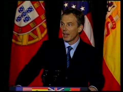 day 18 channel 4 news lib blair speech sot administered by the un in the way we set out side blair speaking at azores summit cms bush at summit - channel 4 news stock videos and b-roll footage